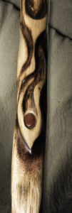 A two-foot tall, three-inch diameter section of an oak staff, burned with artistic representations of flames. The center of the staff image shows an inset red Mookaite Jasper stone.